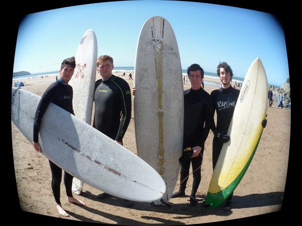 4 Friends On Beach With Surfboards