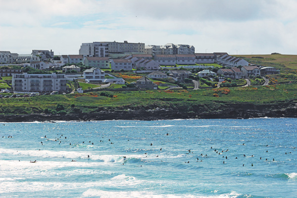 Busy Fistral Beach, lots of surfers